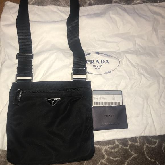 afeea72fe45e Prada black nylon crossbody bag. M_5b062a9772ea88c459316170